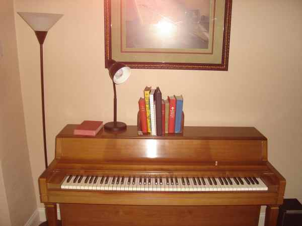 Heather's music books on the piano